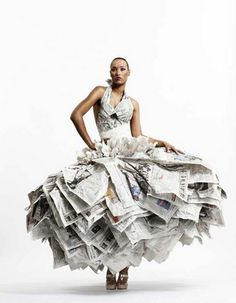 Fashion designer Gary Harvey's Newspaper Dress was part of a stunning exhibition during London Fashion Week in 2007 which showcased a collection of eco-conscious couture. The dress is made from 30 copies of the Financial Times, but there were also dresses made from other second-hand items such as bottle tops and plastic bags, old suits and army jackets, to highlight the throw-away mentality in society by recontextualising them