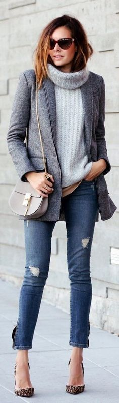 Erica Hoida wears a cute chunky knit pullover with distressed jeans and leopard print heels.