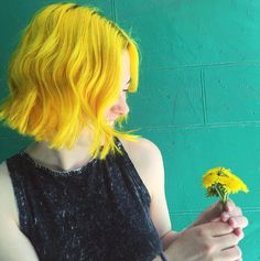 Yellow hair doesn't usually look good in my opinion, but she pulls it off well.