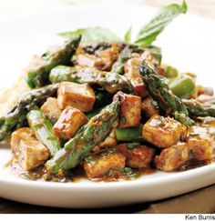 Orange-Roasted Tofu & Asparagus Toss roasted tofu and asparagus in a tangy orange-and-basil-scented sauce, made rich and savory with miso.