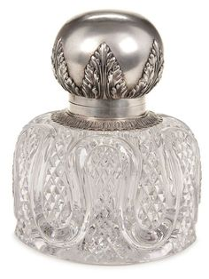 A FABERGE SILVER MOUNTED INKWELL, MOSCOW 1899-1908. The large crystal well with fine cut diamonds interspersed within an endless loop and with star cut base. Mounted with a silver bulbous shape hinged lid with acanthus collar and decorative elements. Hallmarked Moscow, circa 1899-1908, in Cyrillic KF, 84 standard and further marked in Cyrillic K FABERGE beneath the Imperial Warrant. Height 6 inches (15 cm). - Jackson's International Auctioneers and Appraisers