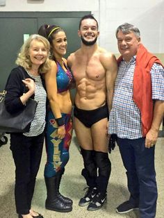 Bayley and Finn with his parents.