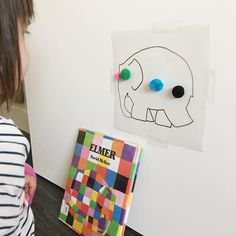Sticky pompom elmer - see previous post - i traced elmer onto a piece of contact paper and placed it as an invitation to stick the pompons and create a colourful elmer 🐘