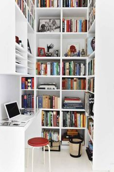 Liked on Pinterest: love the use of this small nook as a home office / library. clever and excellent feng shui tall shelving and colourful books bring vibrant energy. not a very comfortable desk though also do not like the shelving right above the desk.. otherwise great job.