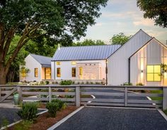 White Metal Siding and light gray metal roof