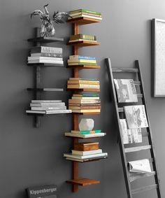 Suspended teak wood column book shelf #furniture_design