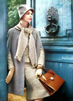 Suit and woolen cape by Manguin, bag by Ferest - December 1958 - L'Officiel - Photo by Philippe Pottier