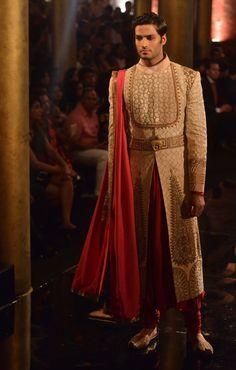 Model walking on the ramp for JJ Valaya at the BMW India Bridal Week (IBFW) 2014.