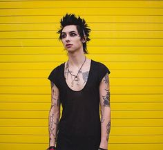((FC: Remington Leith)) Hey, I'm Garret. My mother is Catwoman. I'm 19 and of course, a villain. I also am not that fond of cats. I don't have powers, but I have a gun and I know how to use it. I can fight and use many weapons. My best friend is Peter, and we get along great. Two psychos in a pod, right? I'm bisexual. Come introduce yourself like I may or may not kill you.