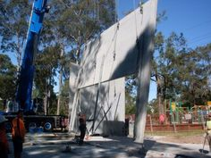 Concrete tilt panels can make a construction project move along quickly. The panels can be made before they arrive at the site. There is less time spent waiting for concrete to dry and walls to be built. It's an innovative way to construct a building.