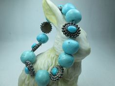 THIS STRIKING, STRETCH BRACELET HAS A SIMPLISTIC BEAUTY.  ROBIN EGG BLUE GLASS BEADS COMBINE WITH METAL AND TURQUOISE BEADS TO CREATE A VERY TRADITIONAL, BUT MODERN LOOK.  ...