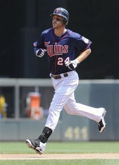 Minnesota Twins' Trevor Plouffe rounds the bases on his solo home run off Kansas City Royals pitcher Bruce Chen in the second inning of a baseball game on Sunday, July 1, 2012, in Minneapolis