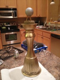 Homemade golf trophy I made for the guys' golf tournament. $5 total from the dollar store!
