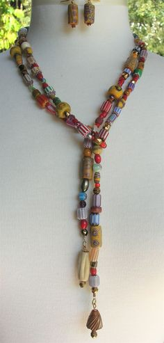 by Sandra Francour | Necklace; a long rope necklace made up predominately of antique and vintage African trade beads ~ majority are Venetian and Bohemian glass beads ~ but there are also some old bodom beads.