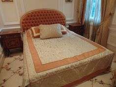 Lot 347 - King size bed with an elegant arched headboard with upholstered central panel with a Hypnos base and