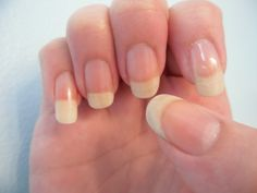 Make your natural nails white by bleaching them in a solution of 1 tablespoon of 3% hydrogen peroxide mixed with 2 1/2 tablespoons of baking soda. Use a cotton swab to press some of the mixture (it should achieve a paste-like consistency) firmly under the tip of each nail as well as over the top of the nail, covering all the nails on one hand. Allow the mixture to remain in place for about three minutes before rinsing with warm water. Repeat with other hand.