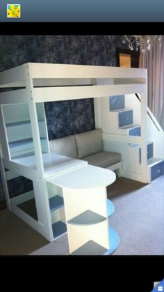 Loft bed with seats and a desk