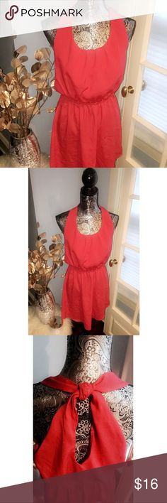 Coral dress with knotted back This fun and sassy number is sure to brighten up your wardrobe. Wear it with leggings or just with some sandals or heels! Cinched at the waist, this dress falls beautifully on any figure. Dresses Mini