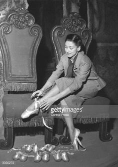 English ballerina Margot Fonteyn (1919 - 1991) of the Sadler's Wells Ballet Company trying on ballet shoes in Milan, where she is performing at the Scala in Ciaikpwski's ' La Bella Addormetat Nel Bosco'.