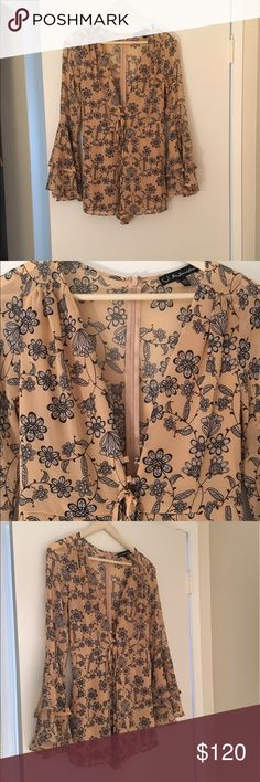 For Love & Lemons Floral Romper For Love & Lemons Floral Romper. Deep V-neck. Peach pink. Abstract Floral print. Flouncy armholes. Lined. Only worn once! For Love and Lemons Other