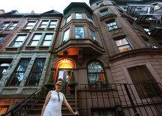 """Jennifer Houlton-Vinyl outside the brownstone on West 94th Street that her parents bought in 1960, when the block was seedy. New York Times story """"Once an $18,000 Home on a Decaying Street, Now a $5 Million Gem."""""""