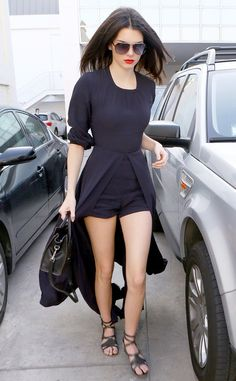 Sass Factor from Kendall Jenner's Street Style She turns heads in a dramatic Sass & Bide high-low romper and bold red lips.