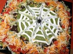Halloween 7-Layer Dip // @Regina Fleming Are you having the halloween party this year again? I keep seeing things that might be fun.