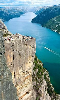 """The preachers chair"" Norway. 650 meter free fall down to the fjord. Awesome place on the world heritage list."