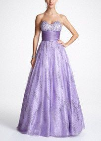 It's not a party until you show up and this ball gown promises just the right amount of glitter, glamour and glitz to help you get your prom groove on!   Shimmering beaded accents on satin bodice and along glittering tulle skirt provide the perfect amount of texture, depth and drama.  Available in Lilac. Sizes 2-16.  Back Zip. Fully Lined. Dry Clean Only. Imported. Available in Plus sizes as Style DB23W.