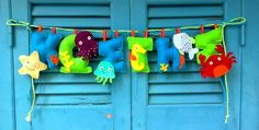 Felt banner with a boy's name in blue and green. The under the sea creatures are super cute! Felt Name, Felt Banner, Under The Sea Party, Name Banners, Sea Theme, Sea Creatures, Hand Stitching, Baby Room, Nursery Decor