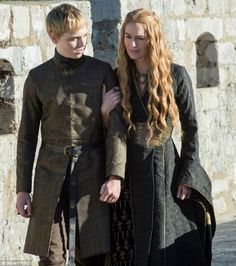 Dean Charles Chapman as Tommen Baratheon and Lena Headey as Cersei Lannister in Game of Thrones Game of Thrones Season 5 Image Gallery Shows New Cast Members Dean Charles Chapman, George Rr Martin, Lena Headey, Sansa Stark, Cersei Lannister Costume, Game Of Thrones Set, Game Of Thrones Costumes, Margaery Tyrell, Winter Is Coming