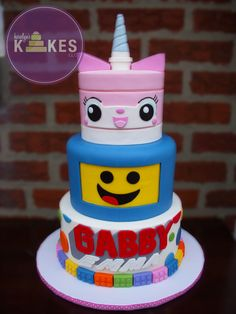 Lego Movie cake! Unikitty and Benny are covered in marshmallow fondant. Logo and Legos are also MMF. Everything is Awesome! Made for my BFFs Gabs and Emma :)