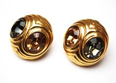 Serendipity Treasures present this pair of gold rhinestone clip on earring by Ciner. These bold  cla