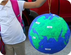 Miss C proudly holds her globe masterpiece! The 4th grader was recently assigned a major school project that will be &helip;