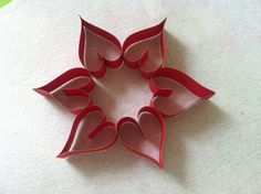 Another easy decorating idea for Valentine - a heart wreath.  Make about 6 hearts, glue them side by side together, add a piece of string and hang.