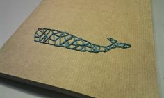 D.I.Y.  Notebook embroidery, blue whale on paper.