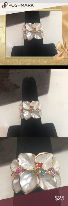 Crystal and Enamel Flower ring Size 7. New. Crystal and Enamel Flower ring Size 7.  New. Beautiful fashion jewelry.  White enamel flowers with beautiful colored Austrian crystals.  Would make a great Christmas gift 🎁 Jewelry Rings