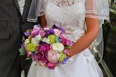 Wedding Bouquet included a plethora of Spring loveliness; Ranunculas, Roses, Sweet Peas, Peonies, Brodea, Viburnum Opulus, Hydrangeas and Alchemilla Mollis