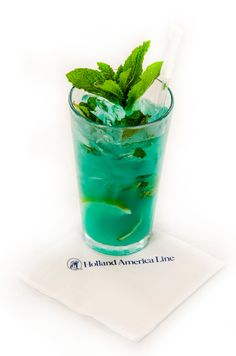 Super Bowl Cocktail - Legion of Boom: Muddle two lemon wedges and a handful of fresh mint leaves in a shaker. Add ice. Pour 1.5 oz. coconut rum, 0.5 oz. Blue Curacao, 1.5 oz house sour and 1.5 oz. soda water into shaker. Shake and strain into pint glass. Garnish with fresh mint.