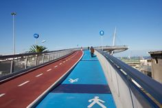 Cyclist/Pedestrian bridge;  photo by Walking path, via 500px