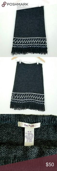 FP Fringe Sweater Skirt FP Fringe Sweater Skirt. Charcoal knit skirt w/ white and blue design and fringe hem. Stretchy elastic waist.  EUC.   Waist 14-18 in Length 23 in (not incl fringe)  No Trade or PP  Bundle discounts  Offers Considered Free People Skirts