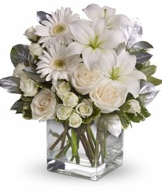 Shining Star-Striking ivory roses, white spray roses, gerberas, asiatic lilies, salal and pittosporum are lovingly arranged and delivered an exclusive sparkling Teleflora clear glass vase. #RAFlorist #SympathyFlowers