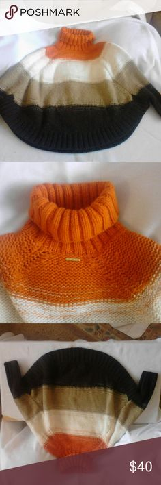 Michael Kors sweater poncho. #MK Orange Spice Wide Striped Be!!!   Turtleneck poncho shawl styling.  Orange Spice! SOLD OUT EVERYWHERE. Last seen at Saks fifth avenue and Nordstroms! In good condition preowned. Perfect bundle item  or make offer! Michael Kors Sweaters Shrugs & Ponchos
