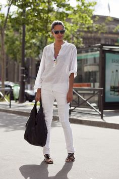 MINIMAL brilliance done by Lakshmi Menon (Supreme, NY). She does a great job of keeping it minimally white, save for the literal pop of color in her necklace and matching black leather bag and sandals.