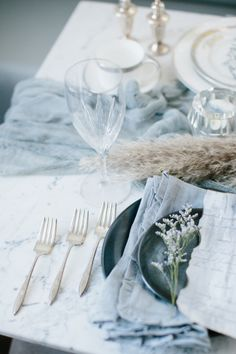 Photography: D'Arcy Benincosa Photography - www.benincosaweddings.com   Read More on SMP: http://www.stylemepretty.com/2015/02/17/50-shades-of-winter-gray-wedding-inspiration/