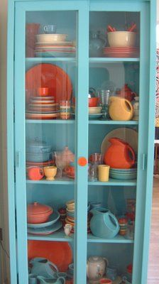 Bright and cheerful! What a pretty cabinet filled with Fiesta Dinnerware.