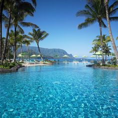 4. St. Regis Princeville, Kauai We're calling it: The view of the lush mountains and dramatic waterfalls that flank Hanalei Bay gets our vote for the most romantic on earth. Add a glam infinity pool, chic rooms, and technicolor sunsets best watched from the resort's open-air restaurant, and you've got a honeymooning made in heaven; St. Regis Princeville.