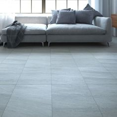 These lovely grey floor tiles with a slight texture are perfect for grey flooring in busy households. Made from hard wearing porcelain they provide a stylish base for modern or classic designs.