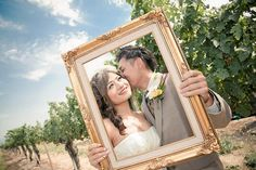 22 Wedding Photo Poses & Ideas {Real Brides} | Confetti Daydreams - Grab a photo frame and pucker up for a romantic pose with your new partner. Shot by Allen Taylor Photography | Featured in Pink & Peach Summer Vineyard Vintage Wedding ♥ #WeddingPhotoPoses #RealBride