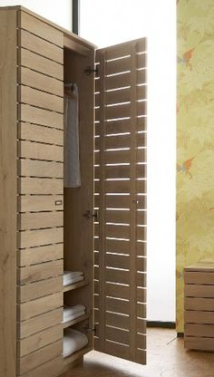 slatted cupboard doors - Option for smaller narrow cupboard idea by the washer